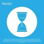 Blue Old Hourglass With Flowing Sand Icon Isolated On Blue Background. Sand Clock Sign. Business And poster