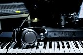 Piano Keyboard With Headphones For Music, Headphones On Piano Keyboard, Close Up,headphones On Elect poster