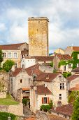 Medieval village of Puy lEveque on the River Lot, Midi Pyrenees, France poster