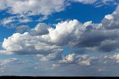 Cloudscape And Skyline, Lush Cumulus Clouds On Bright Blue Sky, Cloudy Weather. Beautiful Natural Sk poster
