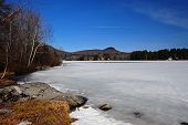foto of hump day  - As the ice on the lake melts under the clear blue spring skies creating this picture - JPG