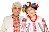 image of national costume  - Mature couple in Ukrainian costumes on a white background - JPG