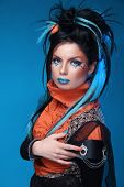 Makeup. Punk Hairstyle. Close Up Portrait Of Rock Girl With Blue Lips And Black Hair Styling With Co