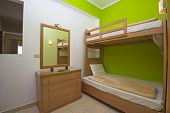 stock photo of bunk-bed  - Bedroom in a luxury apartment show home with interior design - JPG