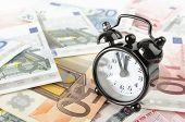 Clock And Euro Banknotes