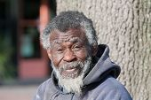 picture of hobo  - Portrait of elderly homeless African American man outdoors during daytime - JPG