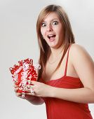 Expressive Woman Holding A Valentine Gift