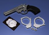 Police Badge, Gun And Handcuffs