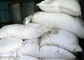 foto of sugar industry  - Sacks full of refined sugar piled up on a pallet - JPG