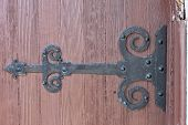 picture of scrollwork  - black iron scrollwork decorative hinge on door - JPG
