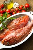 stock photo of redfish  - a dish with fresh Redfish and tomatoes - JPG