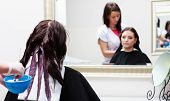 foto of hair dye  - Professional female hairdresser applying color to female customer at design hair salon woman having her hair dyed Hair dye colouring in process - JPG