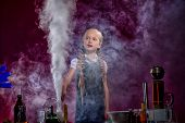 Charmed little girl pocing in cloud of steam