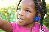 image of cute little girl  - An adorable little African American girl in a pink shirt - JPG