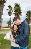 stock photo of wench  - Tourist couple looking at a map of a street - JPG