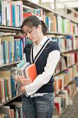Woman Holding Books And Looking Stressed