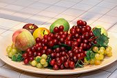 foto of fruit platter  - Fruits platter with red grapes and apples - JPG