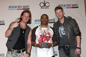 LOS ANGELES - NOV 24:  Tyler Hubbard, Nelly, Brian Kelly at the 2013 American Music Awards Press Roo