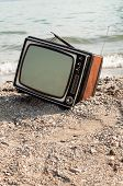 vintage television on the lake shore