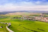 stock photo of tatar  - Spissky hrad village panorama and fortifications from the castle in Slovakia High Tatars region