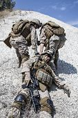 pic of medevac  - US marines evacuate the injured fellow in arms in the mountains - JPG