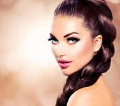 Hair Braid. Beautiful Woman with Healthy Long Brown Hair. Hairdressing. Hairstyle. Beauty Glamour Fa
