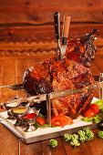picture of spit-roast  - huge chunks of pork roasting on a spit - JPG