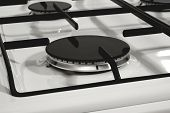 Gas burner without flame on the white metal oven