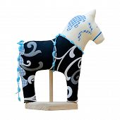 Hand Made Soft Toy Horse Isolated On Black With Blue On The Stand
