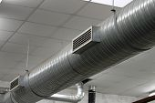 stock photo of aeration  - stainless steel pipes of the heating system within an industry location - JPG