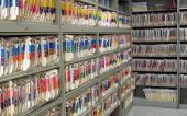 pic of file folders  - Room full of medical files on shelves