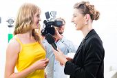 picture of tv sets  - Reporter and cameraman film shoot actress interview on film set for TV or  Television - JPG