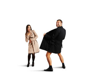 stock photo of exhibitionist  - shocked woman looking at crazy man in coat - JPG