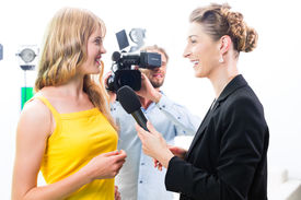 image of tv sets  - Reporter and cameraman film shoot actress interview on film set for TV or  Television  - JPG
