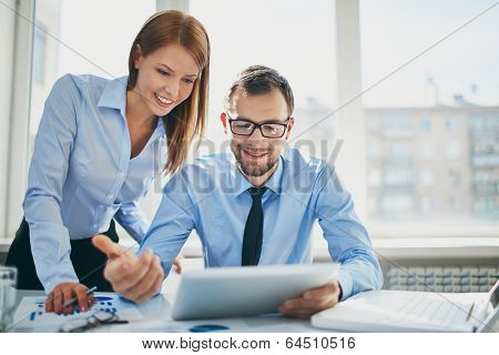 Image of two successful business partners working at meeting in office poster