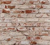 Old Red Brick Wall With Damaged Bricks.