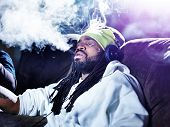 foto of exhale  - exhaling a big puff of marijuana smoke - JPG