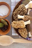 stock photo of morels  - Fresh morel mushrooms on a plate ready to cook - JPG