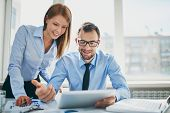 foto of meeting  - Image of two successful business partners working at meeting in office - JPG