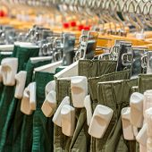 stock photo of theft  - Clothes in the store with EAS anti - JPG