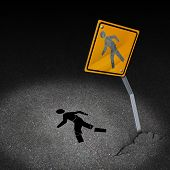 stock photo of pedestrians  - Traffic accident injury concept as a damaged road sign with a person pedestrian symbol fallen on the floor with broken bones and physical pain after a car crash as a metaphor for accident insurance or drunk driving dangers - JPG