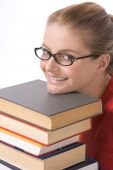 Caucasian Student In Eye Glasses On Pile Of Book
