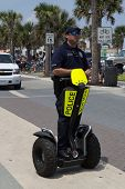 JACKSONVILLE BEACH, FL - APRIL 27, 2014: A police officer on a Segway during the 68th annual Opening