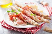 foto of antipasto  - prosciutto ham and grissini bread sticks - JPG