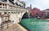 Beautiful sunrise in Venice. Rialto Bridge with Grand Canal VENICE, ITALY - FEBRUARY 27, 2014: Venet