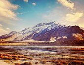 Vintage retro effect filtered hipster style travel image of Spiti Valley -  snowcapped Himalayan Mou