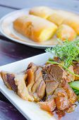 picture of pork belly  - close up braised pork belly on white dish chinese style food