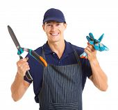 cheerful gardener holding gloves and garden shears