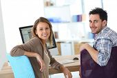 foto of business class  - Business people meeting in front of desktop - JPG
