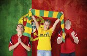 Composite image of various football fans against portugal flag in grunge effect
